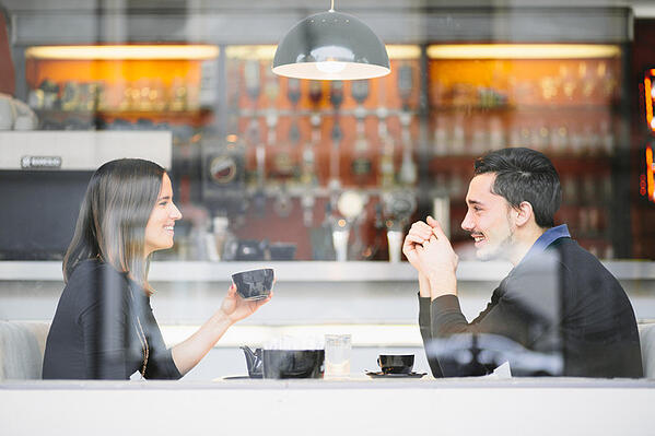 Couple_in_love_drinking_coffee_laughing_in_cafe