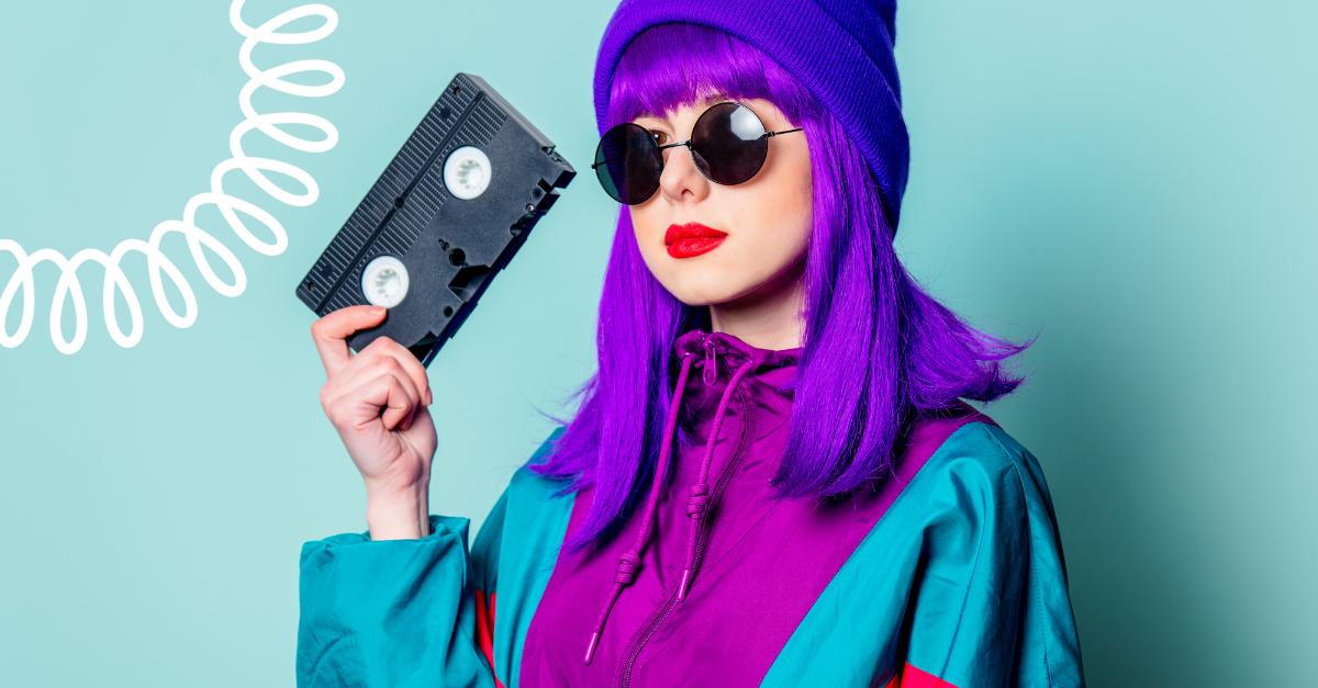 80s woman holding video cassette